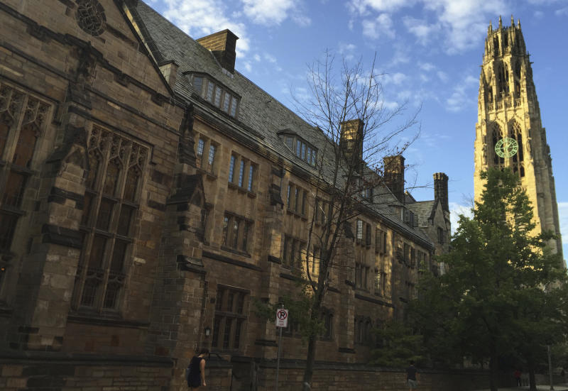 FILE - This Sept. 9, 2016 photo shows Harkness Tower on the campus of Yale University in New Haven, Conn. Dozens of people were charged Tuesday, March 12, 2019, in a scheme in which wealthy parents allegedly bribed college coaches and other insiders to get their children into some of the nation's most elite schools. The coaches worked at such schools as Yale, Wake Forest, Stanford, Georgetown, the University of Texas, the University of Southern California and the University of California, Los Angeles. A former Yale soccer coach pleaded guilty and helped build the case against others. (AP Photo/Beth J. Harpaz, File)