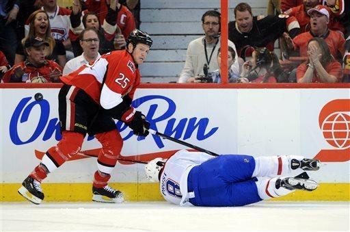 Ottawa Senators' Chris Neil upends Montreal Canadiens' Brandon Prust during the first period of Game 3 of their first-round NHL hockey Stanley Cup playoff series, Sunday, May 5, 2013, in Ottawa, Ontario. (AP Photo/The Canadian Press, Sean Kilpatrick)
