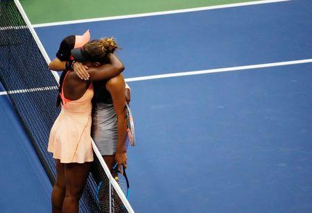 Tennis - US Open - Womens Final - New York, U.S. - September 9, 2017 - Madison Keys (R) of the United States is consoled by winner Sloane Stephens of the United States. REUTERS/Shannon Stapleton