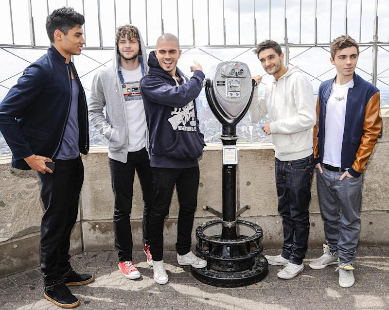 "FILE - In this April 24, 2012 file photo, British boy band ""The Wanted"", from left, Siva Kaneswaran, Jay McGuiness, Max George, Tom Parker and Nathan Sykes visit the Empire State Building in New York. Being a boy band has somewhat haunted the British based-quintet since their formation in 2009: They had to change record labels after being told to learn how to dance. But coming to America _ and achieving some success _ is a dream come true for the group. After releasing two top 5 albums and five hit singles in Europe, they've now duplicated some of that in America with the party jam ""Glad You Came,"" which has spent eight weeks in the top 10 on Billboard's Hot 100 chart. (AP Photo/Evan Agostini, file)"