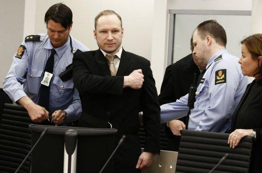 Anders Behring Breivik has pleaded not guilty for his massacre of 77 people in Norway last July in a defiant start to his trial that saw him greet the Oslo courtroom with a far-right salute