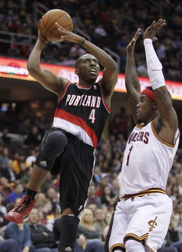 Portland Trail Blazers' Nolan Smith (4) shoots over Cleveland Cavaliers' Daniel Gibson (1) in the first quarter of an NBA basketball game Saturday, Dec. 1, 2012, in Cleveland. (AP Photo/Tony Dejak)
