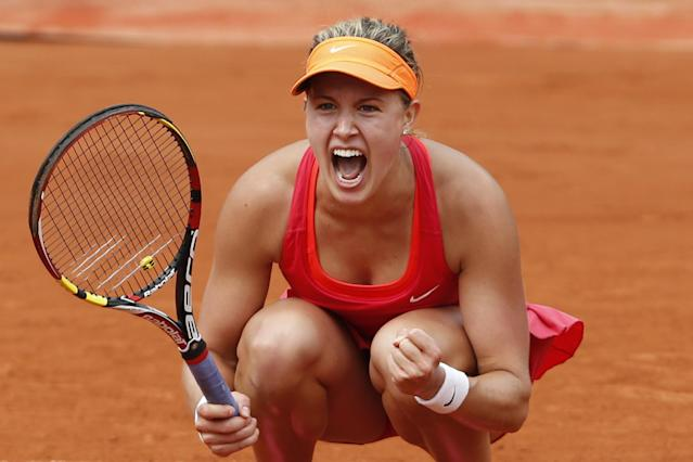 Canada's Eugenie Bouchard celebrates winning the quarterfinal match of the French Open tennis tournament against Spain's Carla Suarez Navarro at the Roland Garros stadium, in Paris, France, Tuesday, June 3, 2014. Bouchard won in three sets 7-6, 2-6, 7-5. (AP Photo/Darko Vojinovic)
