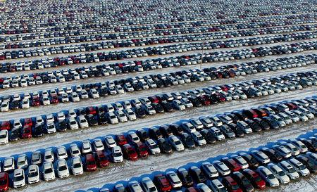 New cars are seen at a parking lot in Shenyang