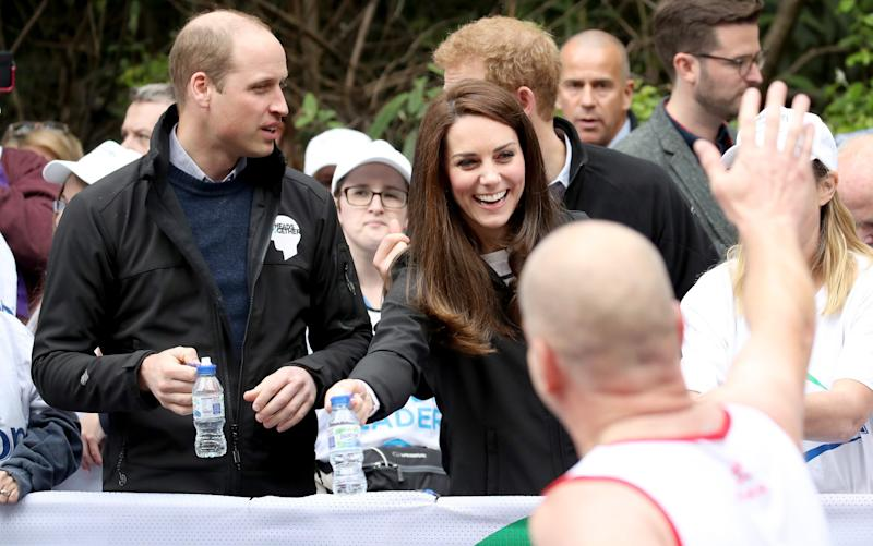 The Duke & Duchess Of Cambridge And Prince Harry wave on a runner - Credit: Chris Jackson - WPA Pool/Getty Images