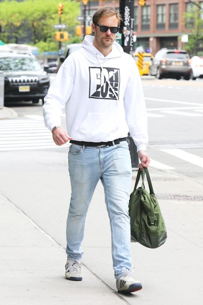 <p>Alexander Skarsgard takes a walk on Tuesday in N.Y.C. in a white hoodie and sunglasses. </p>