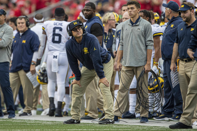 Michigan Wolverines head coach Jim Harbaugh looks on during his team's embarrassing loss to Wisconsin on Saturday. (Getty)