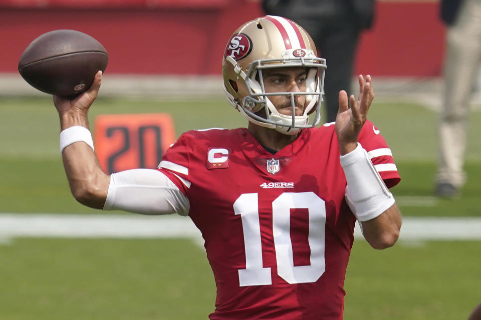 FILE - San Francisco 49ers quarterback Jimmy Garoppolo (10) passes against the Arizona Cardinals during the first half of an NFL football game in Santa Clara, Calif., in this Sunday, Sept. 13, 2020, file photo. The Matthew Stafford-Jared Goff trade not only has whet fans' appetites for big deals, it's caused a social media frenzy about which quarterbacks are headed elsewhere. (AP Photo/Tony Avelar, File)