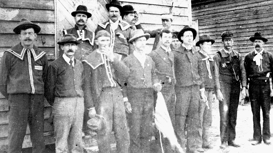 A group of Red Shirts — a white supremacist paramilitary group — poses at the polls at Old Hundred, Scotland County in North Carolina, on November 8, 1898 (Election Day). Some individuals wear pistols and white supremacy buttons.