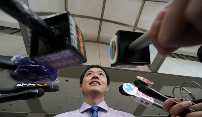 Democratic Party lawmaker Ted Hui speaks to the press at the Eastern Law Courts in Sai Wan Ho after launching a private prosecution against the traffic police officer who shot a protester during a protest last November 2019. Photo: Felix Wong