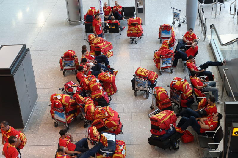 Members of the Spanish Olympic team arrive at Heathrow Airport, in London on Tuesday, July 24, 2012. The opening ceremonies of the Olympic Games are scheduled for Friday, July 27. (AP Photo/Steve Parsons, PA) UNITED KINGDOM OUT; NO SALES; NO ARCHIVE