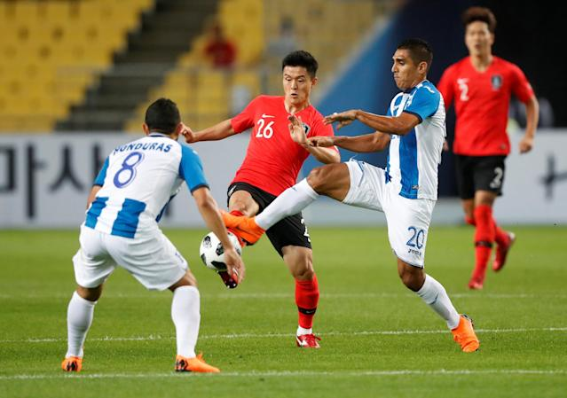 Soccer Football - International Friendly - South Korea vs Honduras - Daegu Stadium, Daegu, South Korea - May 28, 2018 South Korea's Se-Jong Ju in action with Honduras' Jorge Claros REUTERS/Kim Hong-Ji
