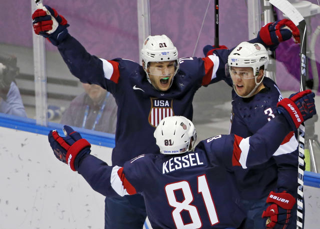USA forward James van Riemsdyk, defenseman Cam Fowler and USA forward Phil Kessel celebrate a goal by Fowler in the second period of a men's ice hockey game against Russia at the 2014 Winter Olympics, Saturday, Feb. 15, 2014, in Sochi, Russia. (AP Photo/Petr David Josek)