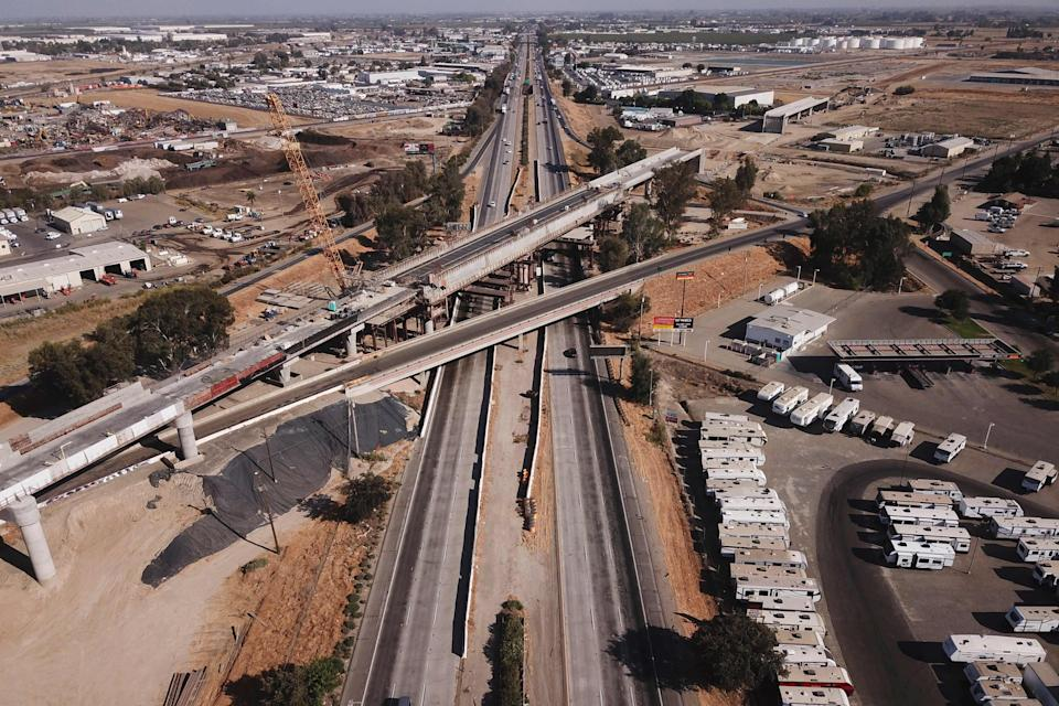 In this aerial image taken on Aug. 26, 2021, the Cedar viaduct stands during construction of a high-speed rail project over State Route 99 through the Central Valley in Fresno, Calif. The Senate passed a bipartisan infrastructure development bill that would see a $1.2 trillion investment in roads, bridges, water pipes and high-speed internet across the United States.