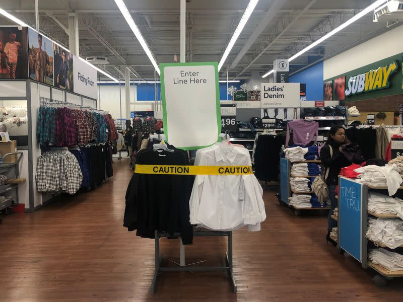 A caution tape is seen by the entrance to a line during a sales event on Thanksgiving day at Walmart in Westbury, New York
