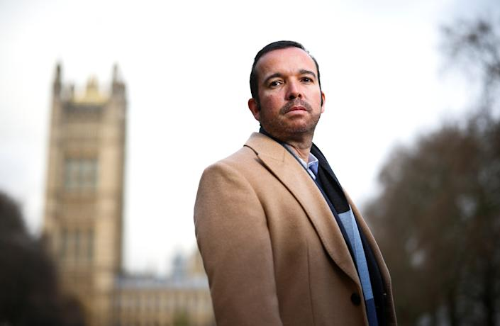 Antonio Mugica, CEO of Smartmatic, poses near the Houses of Parliament in London, Britain, December 11, 2020. Picture taken December 11, 2020. REUTERS/Henry Nicholls