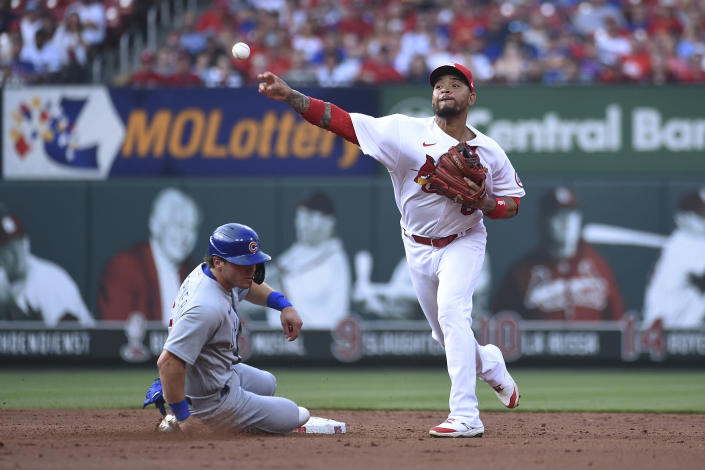 Chicago Cubs' Nico Hoerner, left, is out at second as St. Louis Cardinals shortstop Edmundo Sosa throws out Chicago Cubs' Adbert Alzolay during the third inning of a baseball game Thursday, July 22, 2021, in St. Louis. (AP Photo/Joe Puetz)