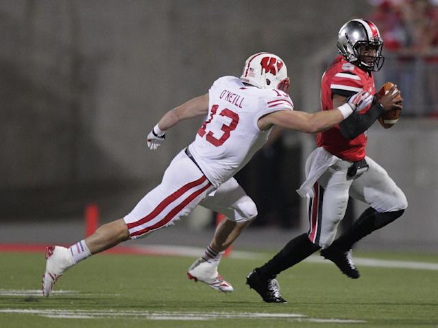 Ohio State quarterback Braxton Miller, right, is run out of bounds by Wisconsin linebacker Conor O'Neill during the first quarter of an NCAA college football game Saturday, Sept. 28, 2013, in Columbus, Ohio. (AP Photo/Jay LaPrete)