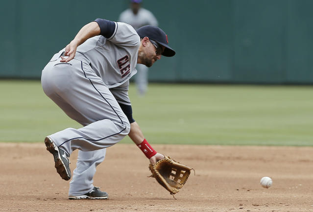 Cleveland Indians third baseman Lonnie Chisenhall fields a hit by Texas Rangers' Rougned Odor during the third inning of a baseball game, Sunday, June 8, 2014, in Arlington, Texas. Chisenhall would throw to first for the out. Cleveland won 3-2. (AP Photo/Brandon Wade)