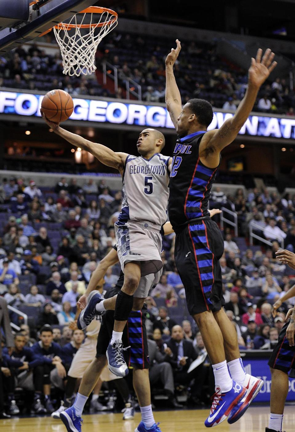 Georgetown guard Markel Starks (5) goes to the basket against DePaul forward Cleveland Melvin (12) during the second half of an NCAA college basketball game, Tuesday, Dec. 31, 2013, in Washington. Georgetown won 61-54. (AP Photo/Nick Wass)