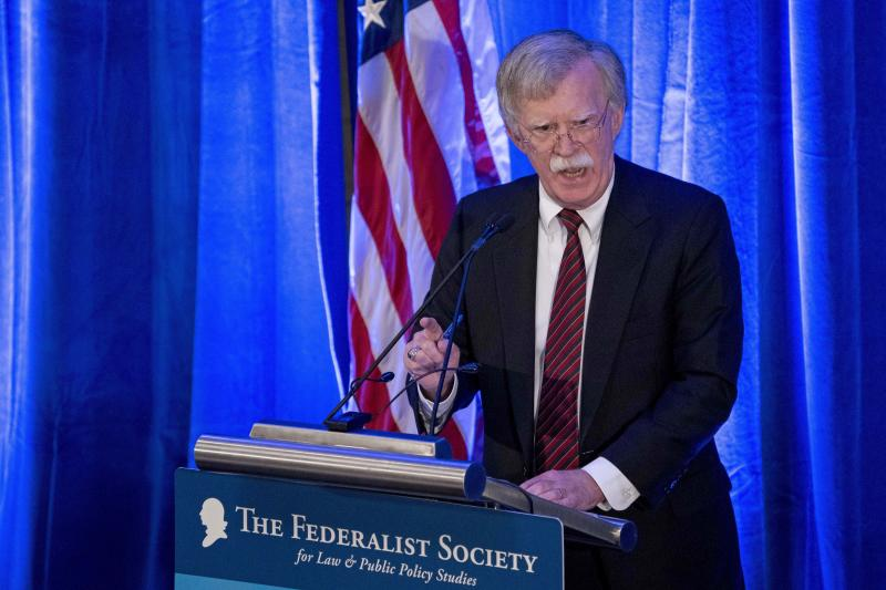 FILE - In this Monday, Sept. 10, 2018 file photo, National Security Adviser John Bolton speaks at a Federalist Society luncheon at the Mayflower Hotel, in Washington. Afghan rights workers are warning that Bolton's blistering attack on the International Criminal Court investigating war crimes allegations will strengthen a climate of impunity in Afghanistan, prolong the war and embolden those carrying out acts of violence. In a speech Monday, Bolton said Washington would not cooperate with The Hague-based court and threatened it with sanctions, saying it put U.S. sovereignty and national security at risk. (AP Photo/Andrew Harnik, File)