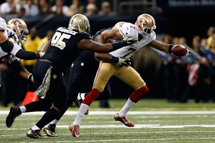 The Saints sacked Colin Kaepernick four times on Sunday. (Getty Images)