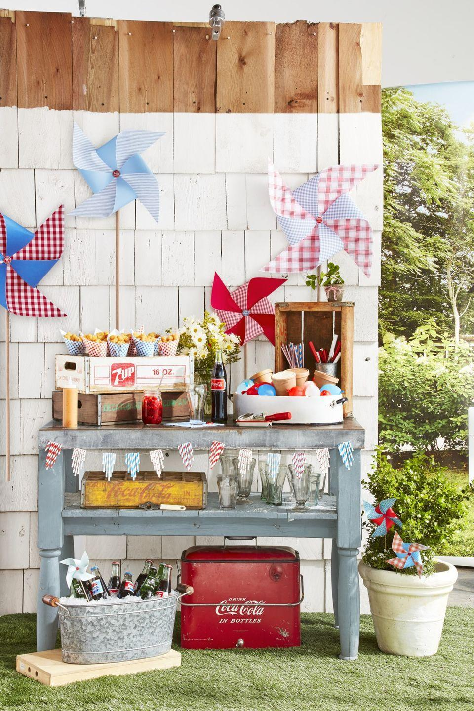 """<p><em>Country Living</em> contributor <a href=""""https://www.countryliving.com/life/entertainment/a27008740/thomas-rhett-lauren-akins-kids/"""" rel=""""nofollow noopener"""" target=""""_blank"""" data-ylk=""""slk:Lauren Akins"""" class=""""link rapid-noclick-resp"""">Lauren Akins</a> helped dream up this genius summer idea, which is perfect for fending off the July heat and keeping your crew refreshed. Channel the 4th of July from decades past with glass soda bottles and a vintage-inspired bar cart. </p><p><a class=""""link rapid-noclick-resp"""" href=""""https://www.amazon.com/TableCrafts-CC322-Coca-Cola-Glass-Dispenser/dp/B000GDMAZ4/?tag=syn-yahoo-20&ascsubtag=%5Bartid%7C10050.g.4463%5Bsrc%7Cyahoo-us"""" rel=""""nofollow noopener"""" target=""""_blank"""" data-ylk=""""slk:SHOP STRAW DISPENSERS"""">SHOP STRAW DISPENSERS</a></p>"""