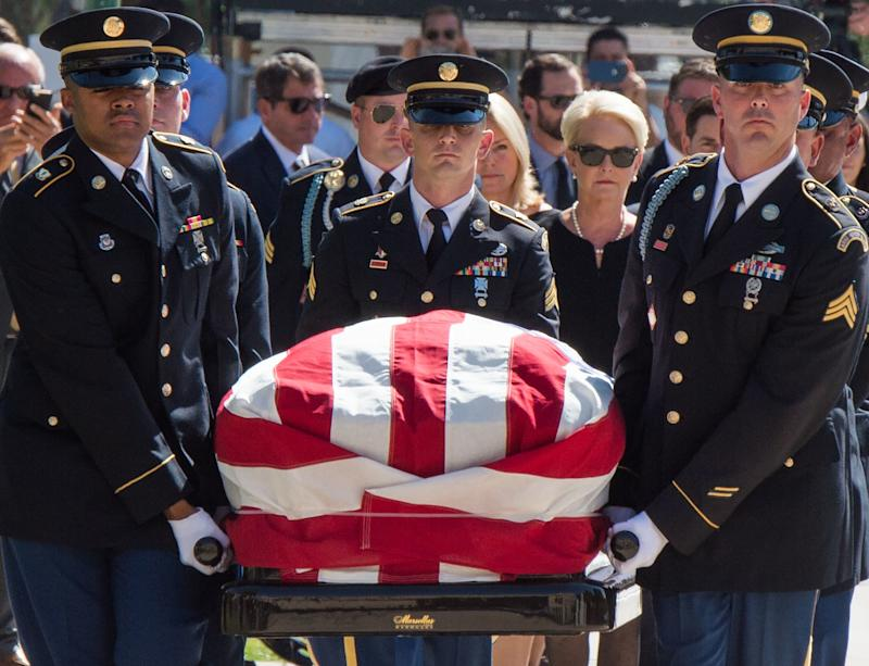 Members of the Arizona National Guard carry John McCain's casket to the state Capitol Rotunda, followed by Cindy McCain, Aug. 29. (ROBYN BECK / Getty Images)