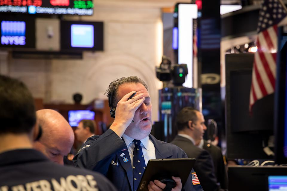 NEW YORK, March 18, 2020 -- Traders work at the New York Stock Exchange in New York, the United States, on March 18, 2020. The S&P 500 tumbled 7 percent at around 1 p.m. Eastern Time, triggering a key circuit breaker that halted trading for 15 minutes. It was the second time this week that the circuit breaker has been tipped. (Photo by Michael Nagle/Xinhua via Getty) (Xinhua/ via Getty Images)