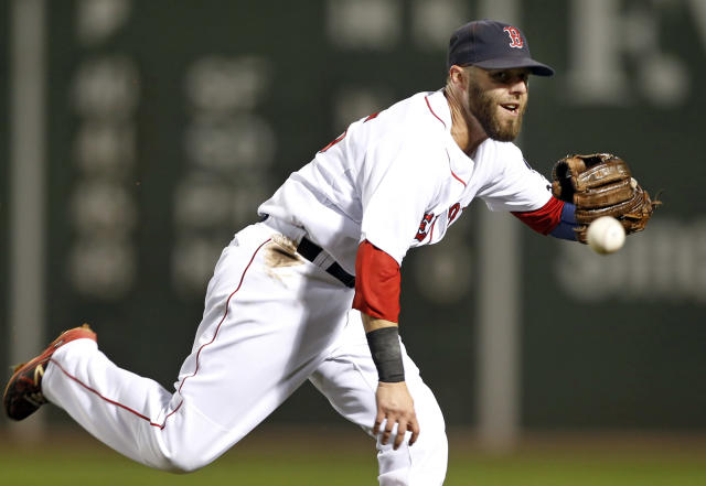Boston Red Sox second baseman Dustin Pedroia can't get to a single by Detroit Tigers' Austin Jackson in the fifth inning of a baseball game at Fenway Park in Boston, Tuesday, Sept. 3, 2013. (AP Photo/Elise Amendola)