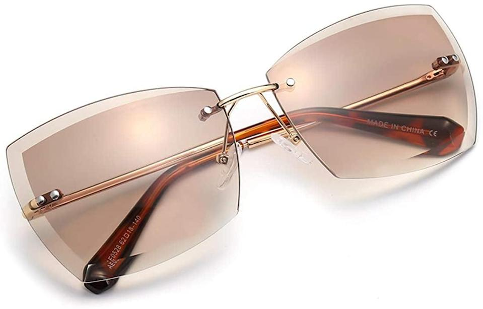 <p>Go out of your comfort zone with these <span>AEVOGUE Oversized Rimless Diamond-Cut Lens Sunglasses </span> ($12).</p>