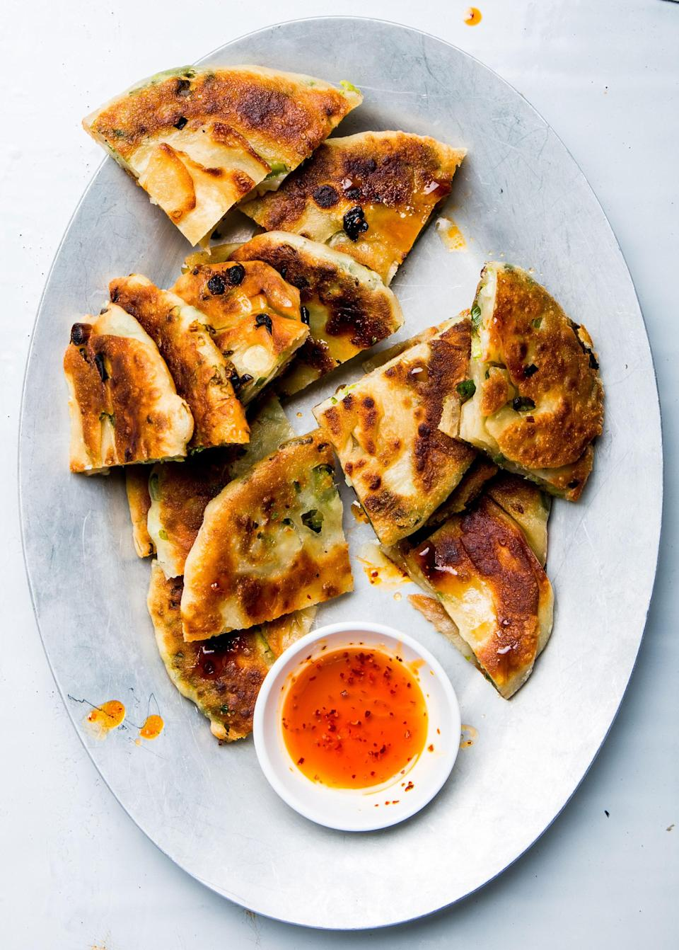 "<h1 class=""title"">Scallion Pancakes</h1> <div class=""caption""> <a href=""https://www.bonappetit.com/recipe/scallion-pancakes-2?mbid=synd_yahoo_rss"" rel=""nofollow noopener"" target=""_blank"" data-ylk=""slk:Like this"" class=""link rapid-noclick-resp"">Like this</a>, but skip the triangle cuts and make it a wrap. </div> <cite class=""credit"">Photo by Alex Lau, Food Styling by Sue Li</cite>"