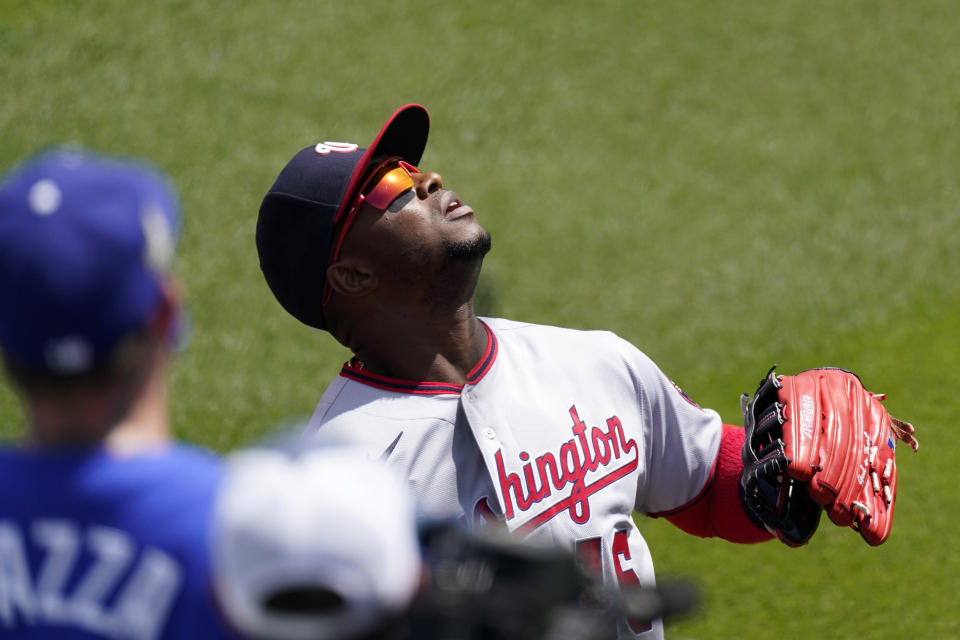 Washington Nationals center fielder Victor Robles tries to field a ball hit for an RBI double by Los Angeles Dodgers' Zach McKinstry as fans watch during the second inning of a baseball game Sunday, April 11, 2021, in Los Angeles. (AP Photo/Mark J. Terrill)