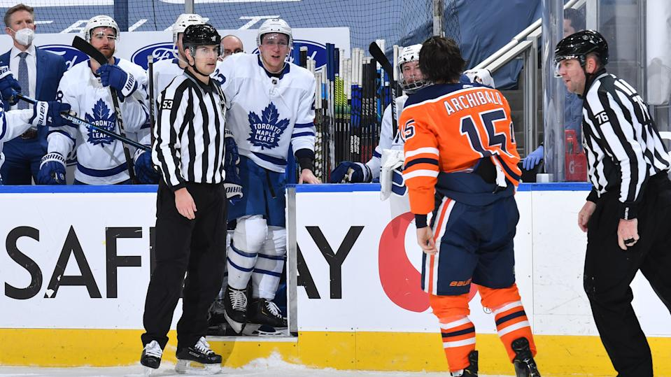 EDMONTON, AB - MARCH 1:  Josh Archibald #15 of the Edmonton Oilers exchanges words with Travis Dermott #23 of the Toronto Maple Leafs on March 1, 2021 at Rogers Place in Edmonton, Alberta, Canada. (Photo by Andy Devlin/NHLI via Getty Images)