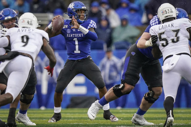 Kentucky quarterback Lynn Bowden Jr. (1) passes the ball during the first half of the NCAA college football game against Louisville, Saturday, Nov. 30, 2019, in Lexington, Ky. (AP Photo/Bryan Woolston)