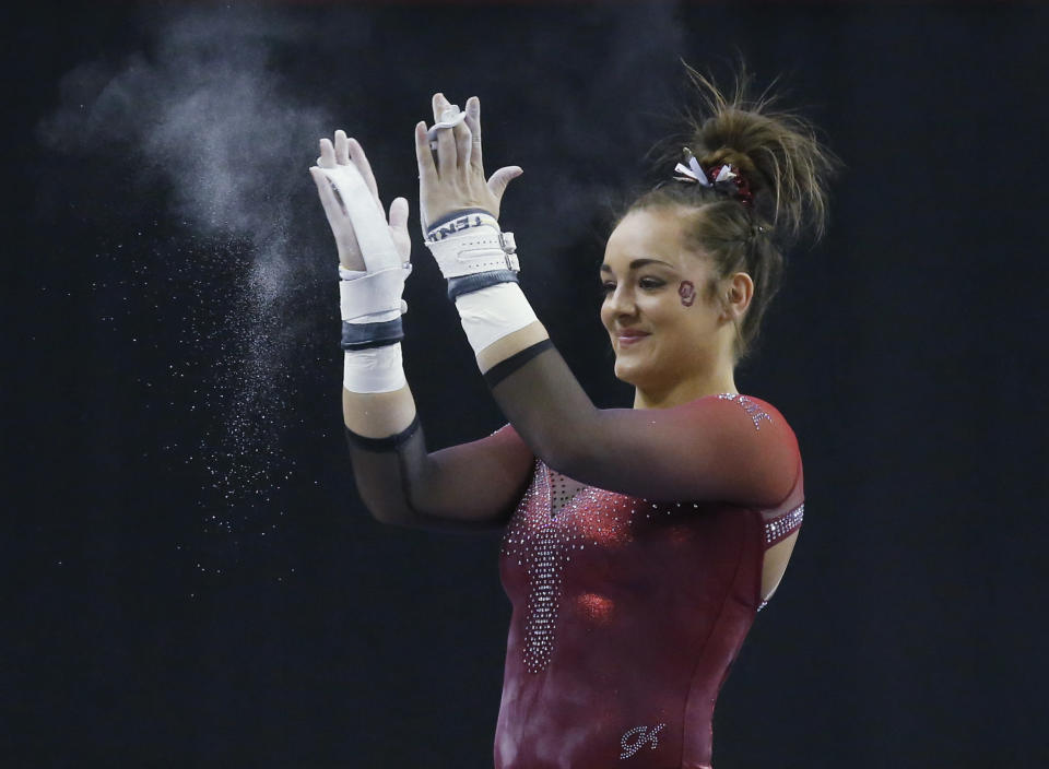 FILE - In this Feb. 16, 2019, file photo, Oklahoma gymnast Maggie Nichols reacts after her routine on the uneven bars in the Perfect 10 Challenge at the Bart and Nadia Sports Experience in Oklahoma City. Nichols, an alternate on the 2016 U.S. Olympic team, welcomed opportunities for college-bound athletes to be compensated for their name, image and likeness. Nichols turned down several opportunities in 2016 to maintain her amateur status. She went on to win a pair of national titles at Oklahoma.(AP Photo/Sue Ogrocki, File)