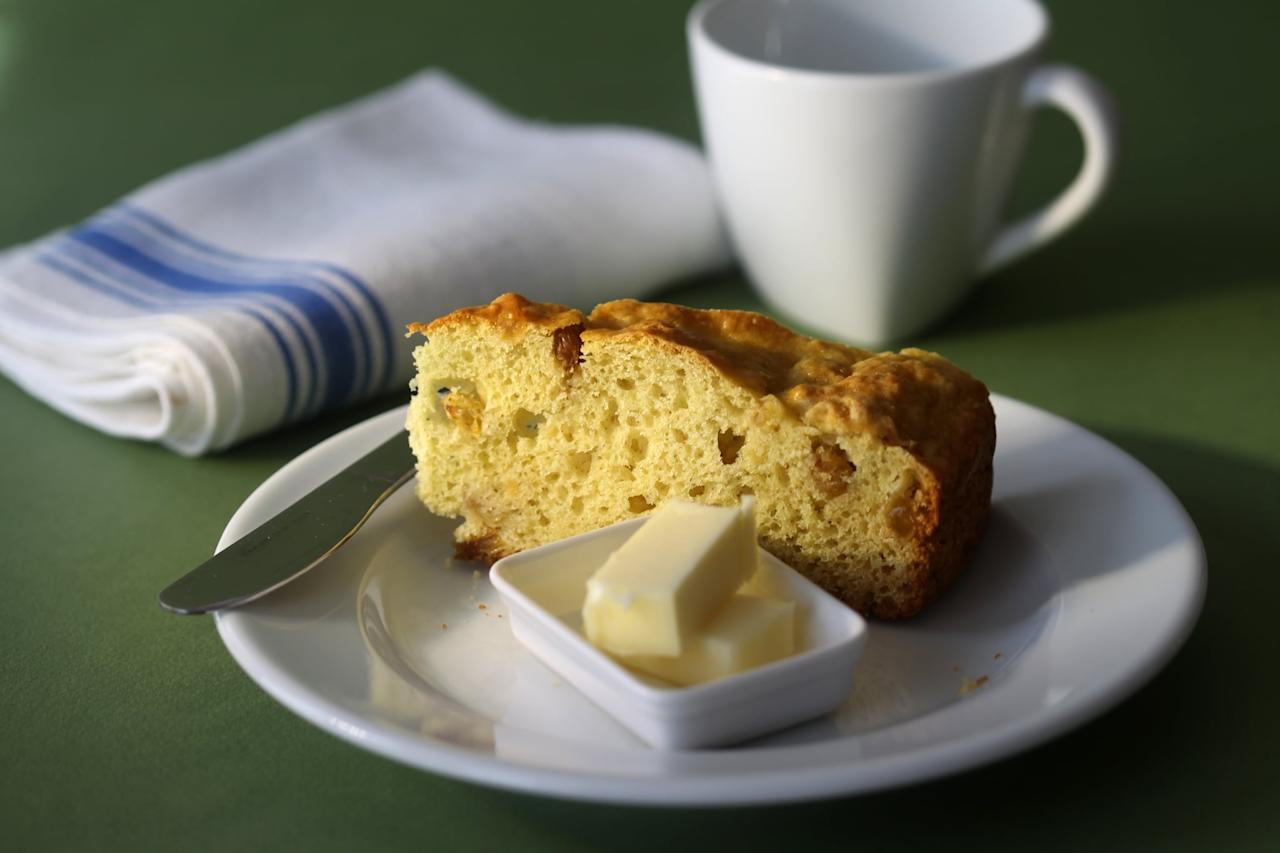 <p>Soda bread gets its name from the leavening agent used instead of yeast: baking soda. It's a dense bread, usually made with dried fruits in it, that relies on buttermilk as a key ingredient.</p>