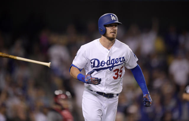 Los Angeles Dodgers' Cody Bellinger tosses his bat after hitting a solo home run during the fifth inning of the team's baseball game against the Arizona Diamondbacks on Saturday, March 30, 2019, in Los Angeles. (AP Photo/Mark J. Terrill)