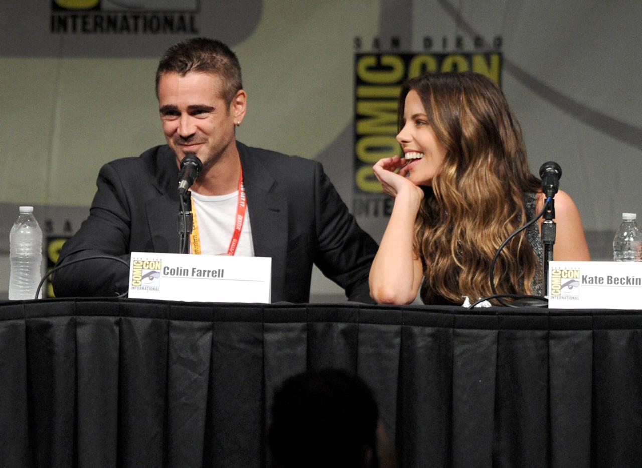 "SAN DIEGO, CA - JULY 13:  Actors Colin Farrell (L) and Kate Beckinsale speak during Sony's ""Total Recall"" panel during Comic-Con International 2012 at San Diego Convention Center on July 13, 2012 in San Diego, California.  (Photo by Kevin Winter/Getty Images)"
