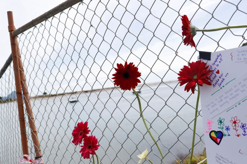 Flowers are seen at a memorial at the harbour in Whakatane, following the White Island volcano eruption in New Zealand