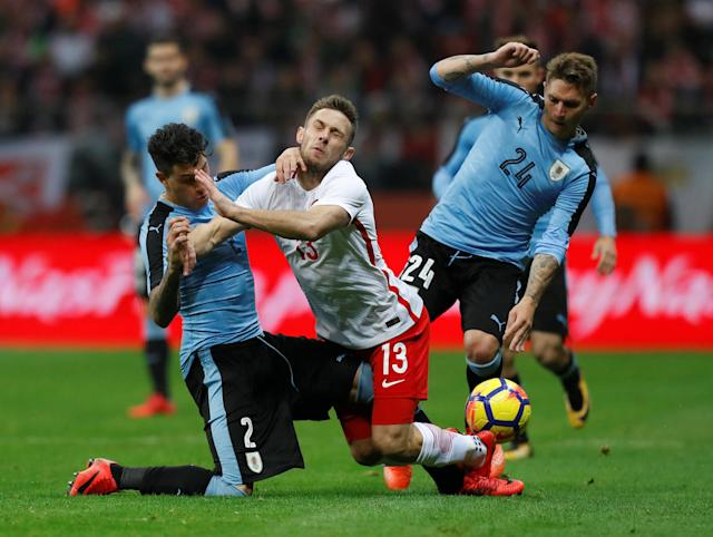 Soccer Football - International Friendly - Poland v Uruguay - National Stadium Warsaw, Warsaw, Poland - November 10, 2017 Poland's Maciej Rybus in action with Uruguay's Jose Gimenez and Gullermo Varela REUTERS/Kacper Pempel