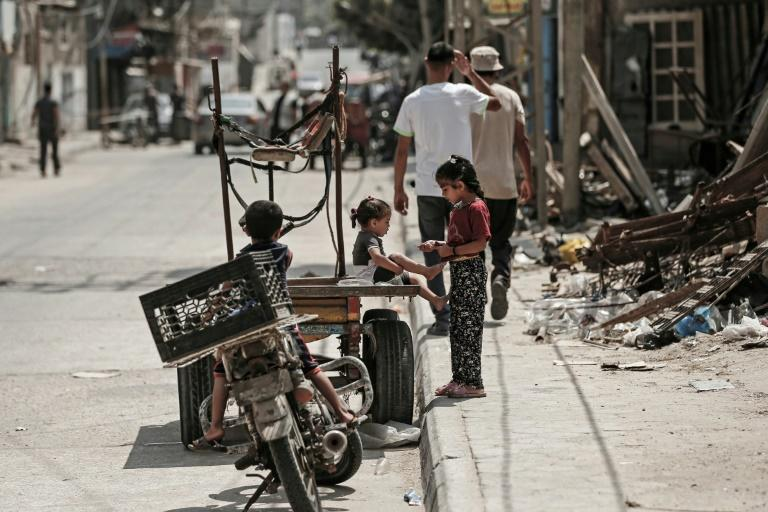 Palestinian refugee children play in a street of the Al-Shati refugee camp in Gaza City on September 1, 2018
