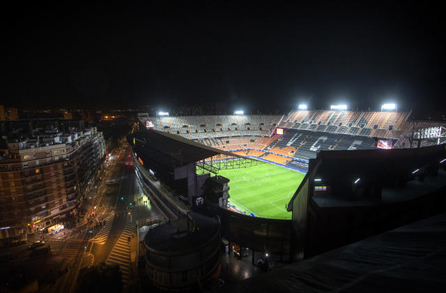 The stadium of Mestalla stadium is lit during the Champions League round of 16 second leg soccer match between Valencia and Atalanta in Valencia, Spain, Tuesday, March 10, 2020. The stadium is empty because of the coronavirus outbreak. (AP Photo/Emilio Morenatti)