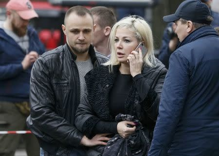 Maksakova, widow of former lawmaker of Russian State Duma Voronenkov, speaks on her phone at scene of murder of her husband in Kiev