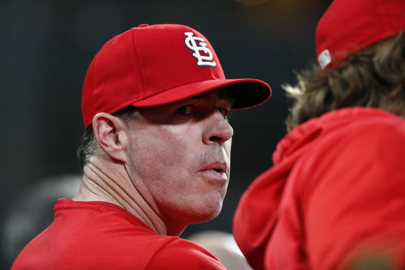 Former St. Louis Cardinals center fielder Jim Edmonds is seen in the Cardinals' dugout during a baseball game against the Cincinnati Reds Friday, April 26, 2019, in St. Louis. (AP Photo/Jeff Roberson)