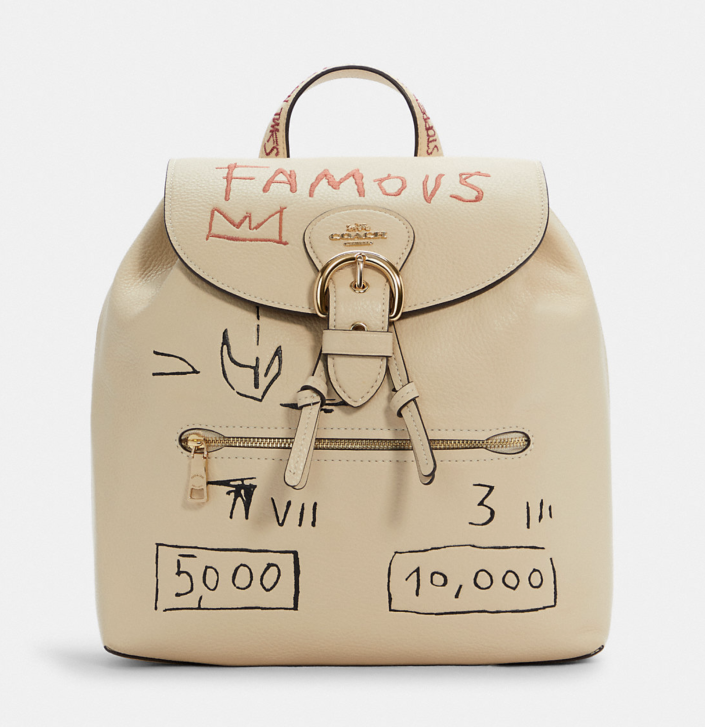 beige Coach x Jean Michel Basquiat Kleo Backpack with famous text and sketches on backpack