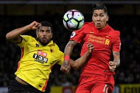 Britain Football Soccer - Watford v Liverpool - Premier League - Vicarage Road - 1/5/17 Watford's Adrian Mariappa in action with Liverpool's Roberto Firmino Reuters / Toby Melville Livepic