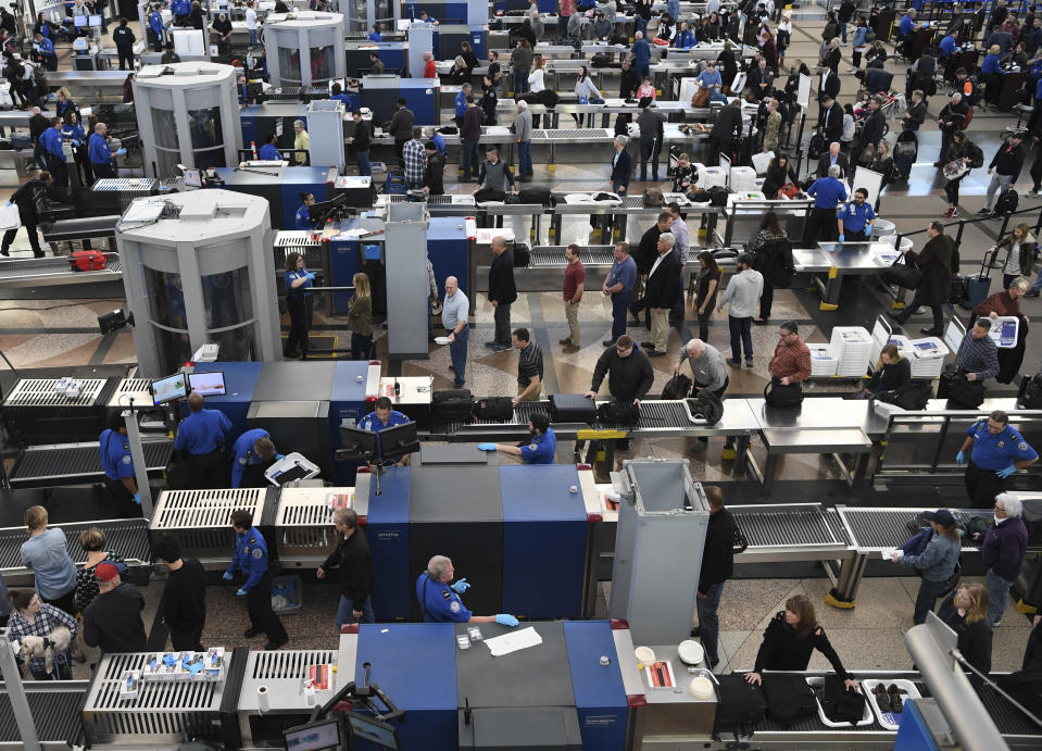 DENVER CO – JANUARY 14: TSA agents at Denver International Airport continue to work without pay after 24 days of the partial government shutdown on January 14, 2019 in Denver, Colorado. (Photo credit: RJ Sangosti/The Denver Post via Getty Images)