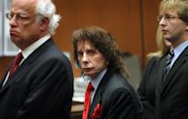Phil Spector looks at the camera for only a moment as the jurors enter the crowded courtroom with his attorneys Doran Weinberg (left) and Tran Smith (right) at his side before the verdict of guilty is read in the case of People v Phil Spector in Department 106 of the Clara Shortridge Foltz Criminal Justice Center in downtown Los Angeles with Judge Larry P. Fidler presiding on Monday afternoon. (Photo by Al Seib/Los Angeles Times via Getty Images)