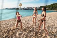 <p>If you prefer the beach over the mountains, grab a few friends for a game of beach volleyball. This team sport encourages communication and focus, and after chasing down a few wild balls, you'll feel like you're getting a workout, too.</p>